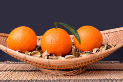 Oranges on bamboo fruit platter Stock Photo