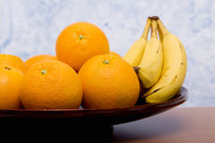 Oranges and bananas Stock Photography