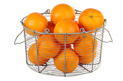 Oranges in a basket. Isolated on white Stock Images