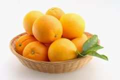 Oranges in Basket. Fresh Oranges stacked in a basket and Isolated stock photos