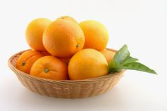 Oranges in Basket. Fresh Oranges stacked in a basket and Isolated stock photography