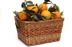 Oranges in the basket. With leaves, isolated Royalty Free Stock Photography