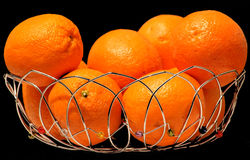 Oranges in basket Stock Photo