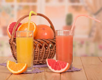 Oranges in basket and juice Royalty Free Stock Photos