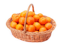 Oranges in basket Stock Photos