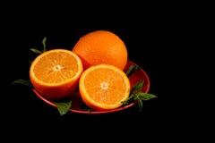 Oranges on black Royalty Free Stock Images