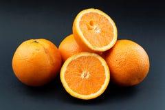 Oranges on black background Stock Image