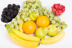 Oranges Blackberries Raspberries Grapes Bananas and Pears on Whi Stock Photography