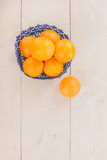 Oranges in blue basket Stock Image