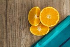 Oranges with blue napkin Stock Photos