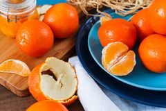 Oranges on the blue plate on dark wooden table. Oranges on the blue plate on dark wooden table Royalty Free Stock Image