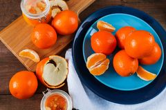 Oranges on the blue plate on dark wooden table. Oranges on the blue plate on dark wooden table Royalty Free Stock Photography