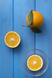 Oranges on a blue wooden table Stock Photography