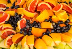 Mouth watering blueberries and oranges. Oranges, blueberries, apples and red grapefruit displayed on plate, food, health, sliced fruit, ready to eat, appealing Stock Photo