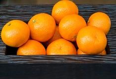 Oranges in Bowl. Oranges in Dark Brown Rectangular Wooden Bowl Royalty Free Stock Photos