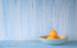 Oranges in a bowl Stock Photos