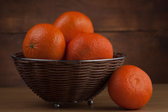 Oranges in a bowl Stock Images