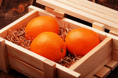 Oranges in a box. Oranges in a wooden box royalty free stock photos