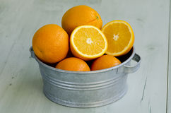 Oranges in a bucket. Stock Photo
