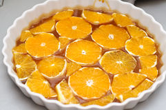 Oranges and caramel sauce. Ready for tart tatin royalty free stock photo