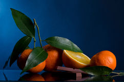Oranges and Chocolate on dark background Stock Photos