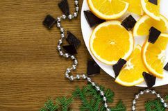 Oranges, chocolate and fir tree branch Stock Photo