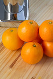 Oranges and chrome citrus juicer Stock Image