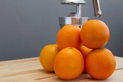 Oranges and chrome citrus juicer Royalty Free Stock Image