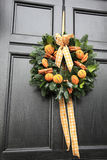 Oranges and cinnamon wreath Stock Photos