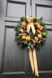 Oranges and cinnamon wreath Stock Photos