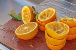 Oranges. Citrus fruits. Some of them squeeze the juice royalty free stock photography