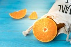 Oranges, close up whole orange fruits and sliced oranges on wood Stock Images