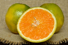 Oranges Closeup. With a Half orange in first plan Stock Images
