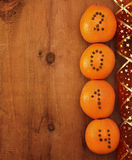 Oranges with clove numbers Royalty Free Stock Photo