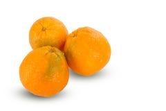 Oranges coupées en tranches mûres juteuses fraîches sur le fond blanc Photo stock