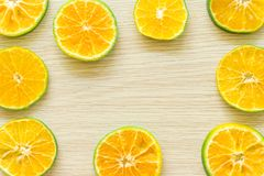 Oranges cut in half on a wooden background, free space stock photography