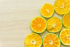 Oranges cut in half on a wooden background, free space royalty free stock photo