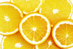 Oranges cut on segments Stock Images