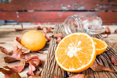 Oranges cut set on old wooden background Royalty Free Stock Image