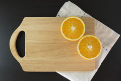 Oranges on cutting board. With napkin Royalty Free Stock Images