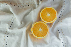 Oranges on cutting board. With napkin Royalty Free Stock Photos