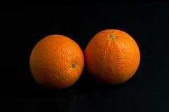 Oranges d'isolement sur le noir Photographie stock libre de droits