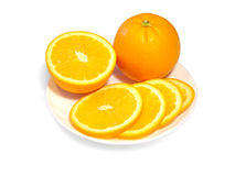 Oranges d'une plaque Photo stock