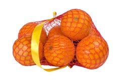 Oranges dans un sac de ficelle Photo libre de droits