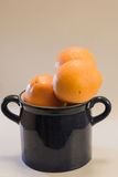 Oranges. In dark blue pot Stock Photo