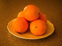 Oranges in a dish. Fruits are full of vitamin C. Photo taken in Drummondville, Quebec, Canada, April 5, 2018 Royalty Free Stock Image