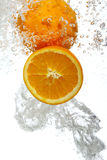 Oranges dropped into water royalty free stock photos