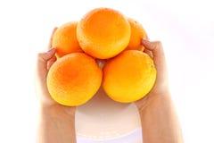 Oranges en biscuits Photos stock