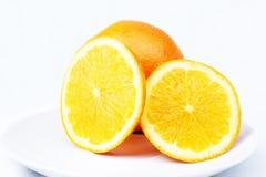 Oranges en coupe Photographie stock