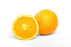 Oranges entières et divisées en deux Photo stock